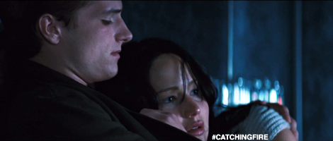Peeta (Josh Hutcherson) comforts Katniss (Jennifer Lawrence) after she awakes from a night terror about their shared experience in the Hunger Games.  Obviously a depiction of the one-note action heroine.